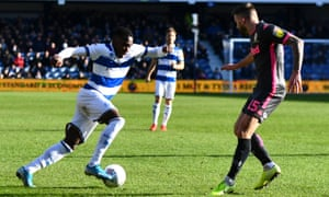 Bright Osayi-Samuel of QPR takes on Stuart Dallas of Leeds United.