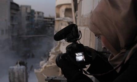 Al-Kateab filming in Aleppo during the civil war.