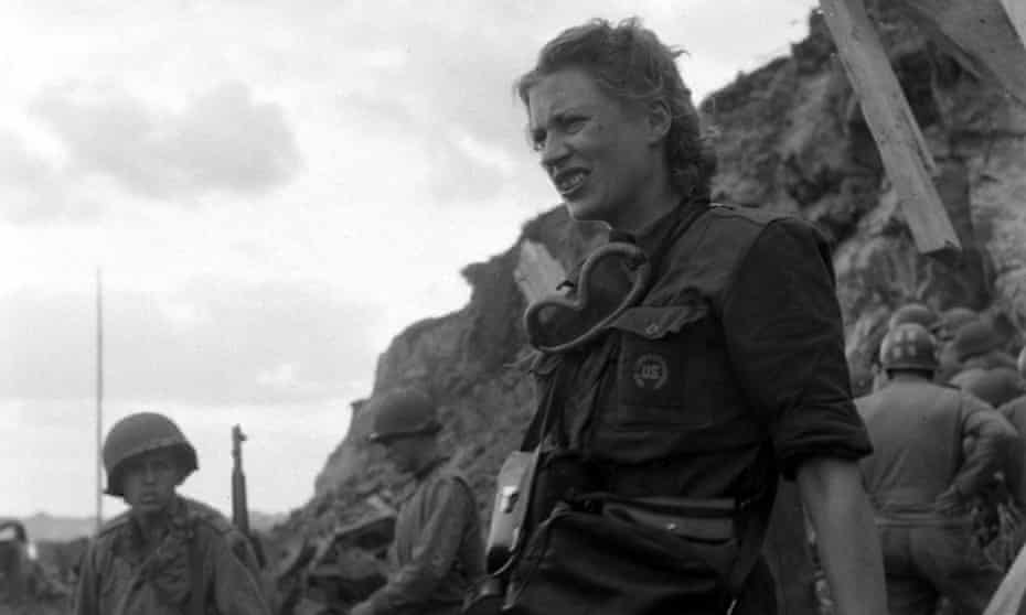 War photographer Lee Miller standing with soldiers during the liberation of Rennes, France, in 1944.