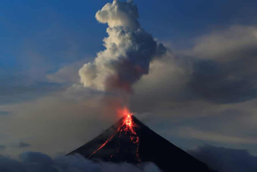 Lava flows from the crater of Mount Mayon volcano