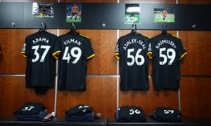 The shirts of Adama Traore, Max Kilman, Benny Ashley-Seal and Oskar Rasmussen hang gently in front of some classy wood panelling.