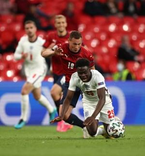 Jan Boril of Czech Republic fouls Bukayo Saka of England.