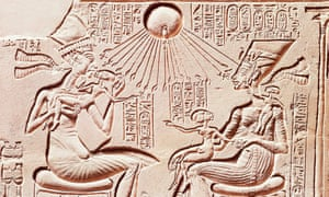 King Akhenaten with his wife Nefertiti and their children under rays of Aten