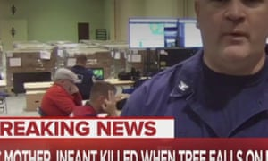 A US Coast Guard worker in the background makes what appears to be a 'white power' hand signal during a TV interview about the response to Hurricane Florence.