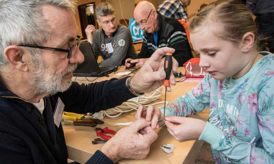 Breaking the seal ... volunteers at work with clients at a branch of Repair Café in Vlaardingen, Netherlands.