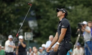 Jason Day reacts after missing a long birdie putt on the 14th.