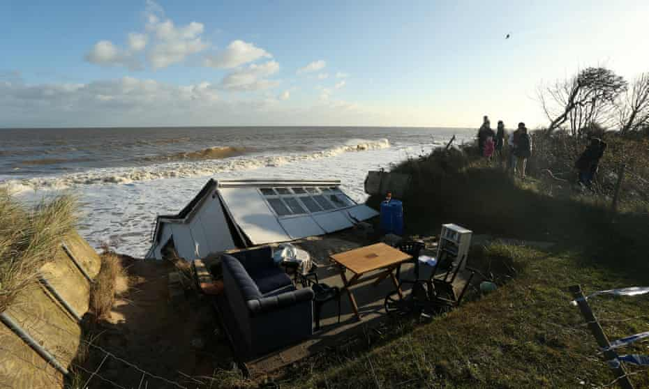 Battered and fallen property on coast at Hemsby, England, in December 2013