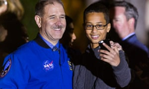 John Grunsfeld poses for a photo with 14-year-old Ahmed Mohamed.