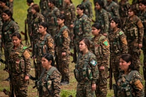 YPJ fighters at a military parade