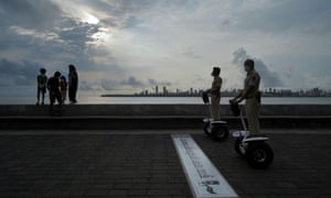 Police officers patrol on Segways along a promenade in Mumbai, India.