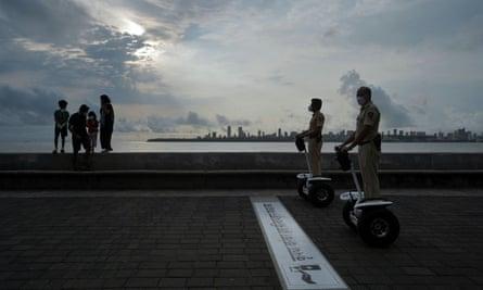 Police officers patrol on Segways along a promenade in Mumbai, India.