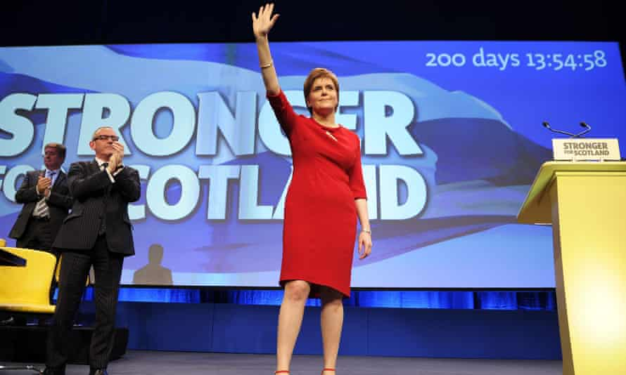 Sturgeon, waves to her supporters after addressing delegates on the final day of the SNP conference in Aberdeen.