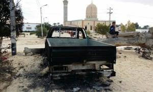 A burned truck outside Al-Rawda mosque in Bir al-Abd northern Sinai, Egypt