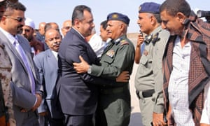 Yemeni prime minister Maeen Abdulmalik Saeed is greeted by an army officer as he arrives at Aden airport