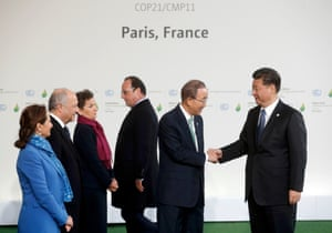 Ban Ki-moon, accompanied by Segolene Royal and Laurent Fabius, secretary of the UN Framework Convention on Climate Change Christiana Figueres, third left, and French [resident Francois Hollande welcomes Chinese president Xi Jinping as he arrives for the opening day of COP21 at Le Bourget in Paris