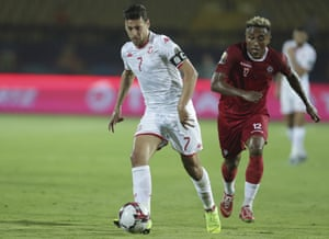 Tunisia's Youssef Msakni in action in front of Madagascar's Lalaina Enjanahary.
