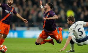 Manchester City's Kyle Walker goes down under the challenge of Tottenham's Jan Vertonghen.