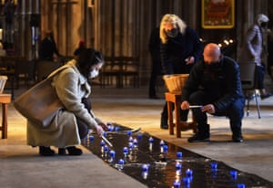 Worshippers light a candles during a service of remembrance held at Lichfield Cathedral