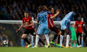 Manchester United's Ander Herrera clashes with Fernandinho and Toure.