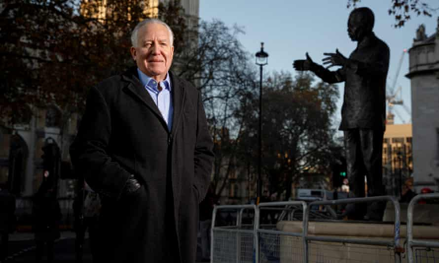 Peter Hain next to a statue of Nelson Mandela in Parliament Square in 2019