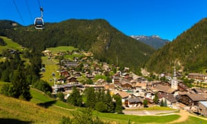 La Clusaz in summer with church tower and cable car