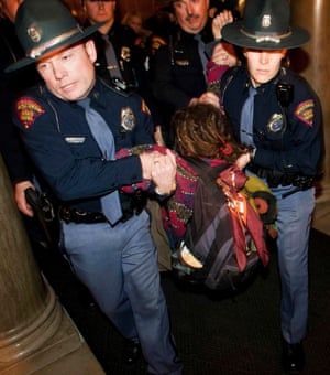 Wisconsin state troopers remove a protestor from the state Capitol, 10 March 2011. The state's Republican governor, Scott Walker, is a committed foe of unions.