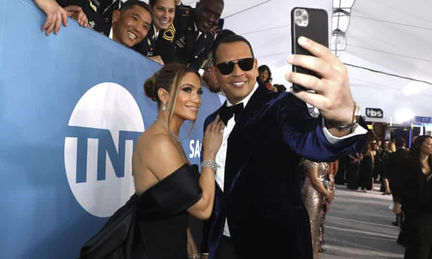 Jennifer Lopez and Alex Rodriguez take a selfie as they arrive at the 26th annual Screen Actors Guild Awards in Los Angeles, California, on 19 January 2020.