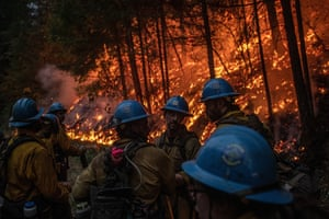 Firefighters from the Carson Hotshots regroup in Klamath national forest, after carrying out a day-long operation to help contain the Slater fire, 17 September 2020.