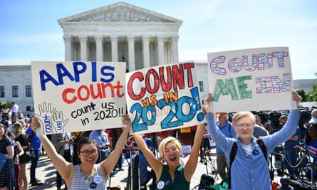Demonstrators rally at the US Supreme Court in Washington, DC, to protest a proposal to add a citizenship question in the 2020 Census