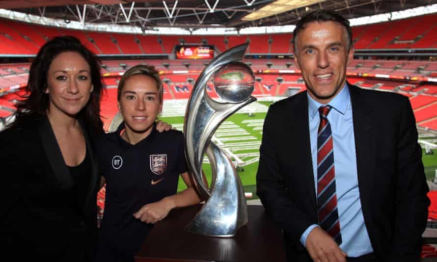 Uefa's head of women's football, Nadine Kessler (left), England international Jordan Nobbs (centre) and England manager Phil Neville with the women's Euro trophy.