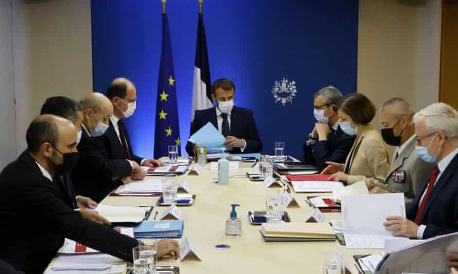 Emmanuel Macron leading a national security meeting on Thursday to discuss the Pegasus project revelations.