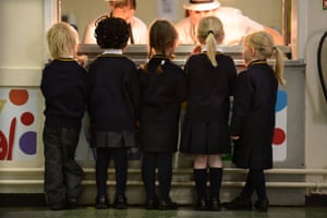 Schoolchildren queuing for toast at Our Lady & St Werburgh's Catholic Primary school in Newcastle-under-Lyme.