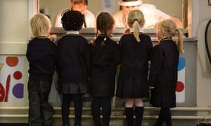 Schoolchildren queuing for food
