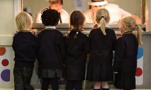 Schoolchildren queuing for breakfast.