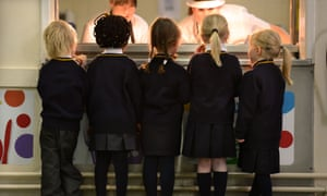 Schoolchildren queuing for breakfast at a Newcastle primary school. In England as a whole, fewer than a quarter of those receiving free school meals go on to university