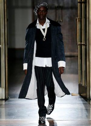 A model walks the runway at the Wales Bonner show, London men's fashion week, January 2017.