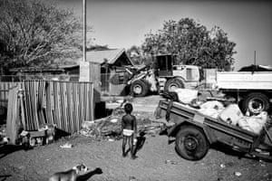Ingetje Tadros's photo of Meah, a five-year-old, standing outside her family home watching a bulldozer demolishing Kennedy Hill's Office in Broome.