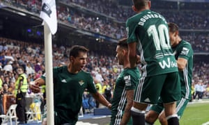 Real Betis players congratulate Antonio Sanabria, centre, after his dramatic late strike.