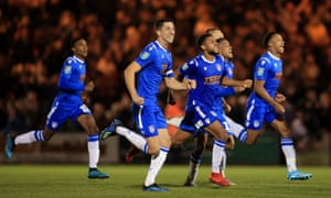 Colchester United players enjoy the moment as they knock Tottenham Hotspur out of the League Cup.
