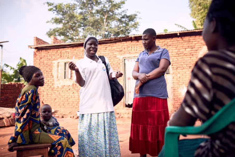 In Mbale, Amina Musenero, a health volunteer, meets community members