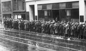 Men line up for bread in the Great Depression of the 1930s