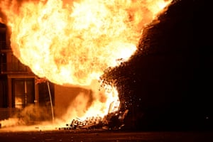 A bonfire in the Sandy Row area collapses after it is lit by petrol bombs
