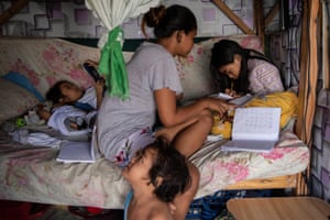 'It's important for me to finish my studies so I can help my parents in the future,' said grade 3 student Mary Joyce Florendo, 8, pictured at home with her mother and siblings