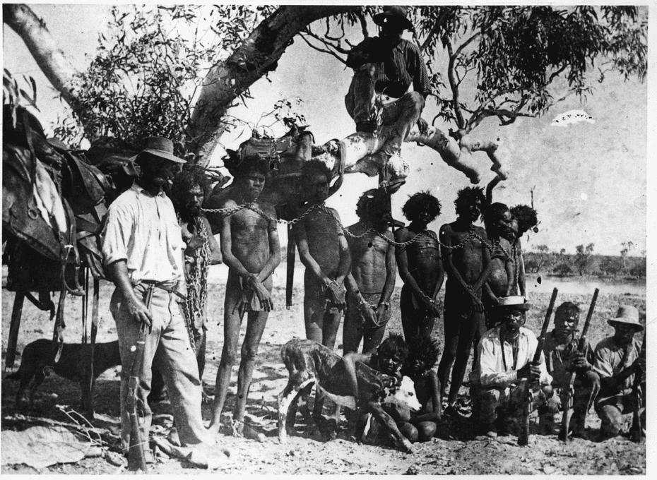 Indigenous Australians in neck chains.