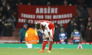 Arsenal's Alex Oxlade-Chamberlain is dejected after the final whistle.