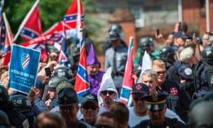 Members of the Ku Klux Klan and others arriving for a rally, calling for the protection of Southern Confederate monuments, in Charlottesville, Virginia on 8 July 2017.