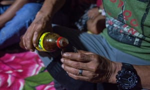 A shaman prepares the medicine to be used during the ayahuasca ceremony