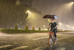 Shenzhen, China A citizen rides in torrential rain after typhoon Hato landed in Shenzhen, Guangzhou province