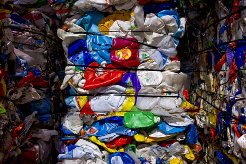 Plastic bottles bundled in a recycling facility. Bales such as these travel around the world on shipping containers.