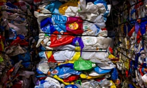 Discarded plastic bottles made of high density polyethylene waiting to be recycled.